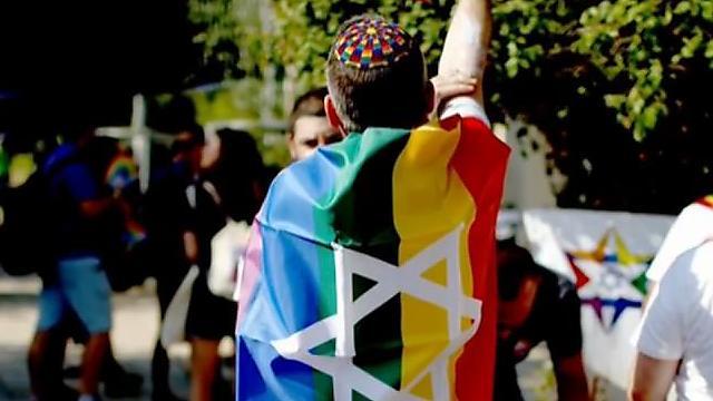 A religious LGBTQ activist at the parade