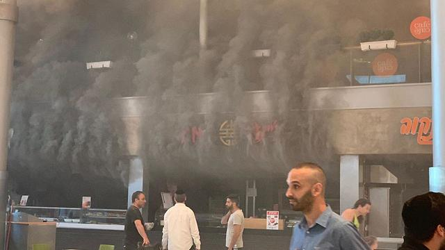 Thick smoke billows out during a fire at Ayalon Mall in Ramat Gan on Tuesday