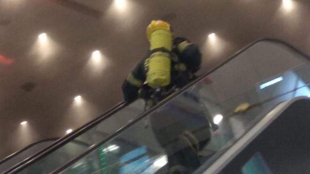 A firefighter makes his way towards a blaze at Ayalon Mall in Ramat Gan on Tuesday
