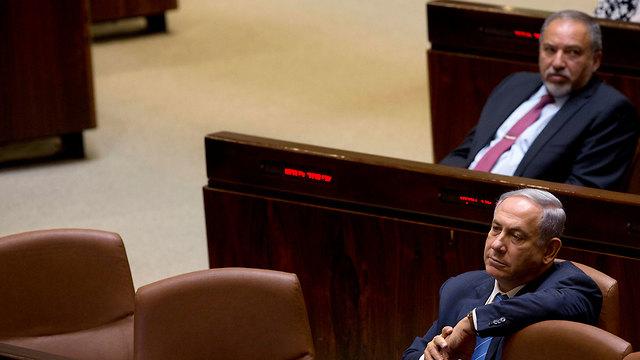 Benjamin Netanyahu and Avigdor Liberman in the Knesset (Photo: AP)