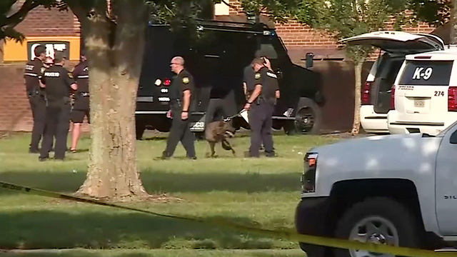 A police canine unit stands by in this still image taken from video following a shooting incident at the municipal center in Virginia Beach, Virginia, U.S. May 31, 2019. (Photo: Reuters)