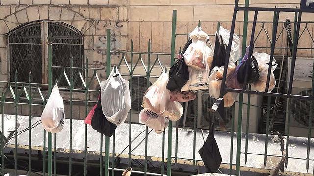 Trash hanging on fences