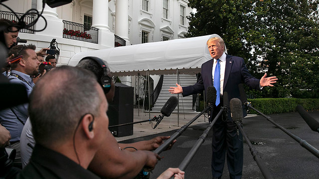 U.S. President Donald Trump speaks to reporters as he prepares to head to Europe Sunday (Photo: AP)