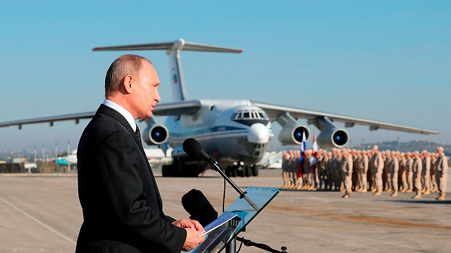 President Putin speaking to Russian troops near Latakia