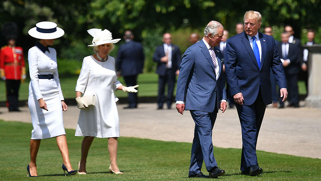 resident Donald Trump walks with Prince Charles and first lady Melania Trump walks with Camilla, the Duchess of Cornwall, after arriving at Buckingham Palace, Monday (Photo: AFP)