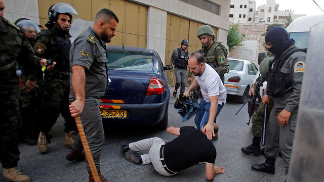 Palestinian security forces beat a man who sought to perform Eid al Fitr against a ruling by Jerusalem's Grand Mufti to perform the holiday on Wednesday