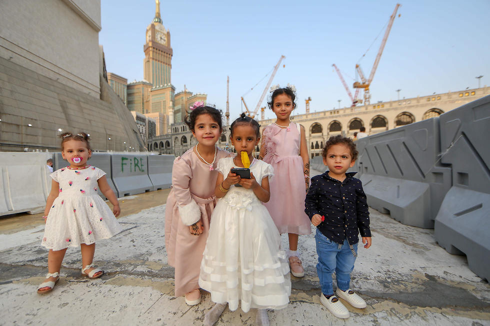 Children pose for a photo at Mecca's Grand Mosque