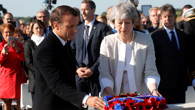 French President Emmanuel Macron and British Prime Minister Theresa May at a military cemetery in Normandy for the 75th anniversary of D-Day (Photo: Reuters)