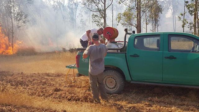 Firefighters battle a blaze in Be'eri Forest  (Photo: JFL-KKL)