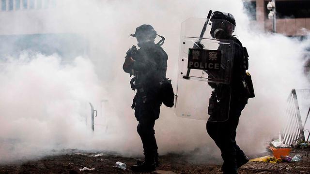 הפגנות הפגנה עימותים מחאה הונג קונג נגד חוק ההסגרה הסגרה ל סין (צילום: AFP)