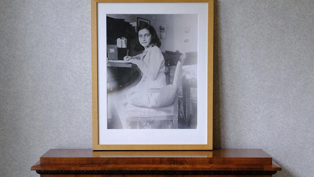 A photo of Anne Frank stands on a replica of the writing desk she once used in her family's former apartment in Amsterdam, during an event to mark what would have been her 90th birthday, in Amsterdam, June 12, 2019