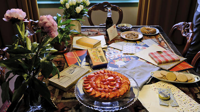 A table is decorated with replicas of gifts Anne Frank received for her 13th birthday - including her first diary - during an event at her family's former apartment in Amsterdam to mark what would have been the teenage Jewish diarist's 90th birthday June 12, 2019