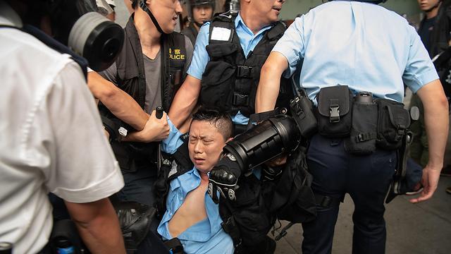 הפגנה מפגינים מחאה הונג קונג נגד חוק ההסגרה לסין (צילום: gettyimages)