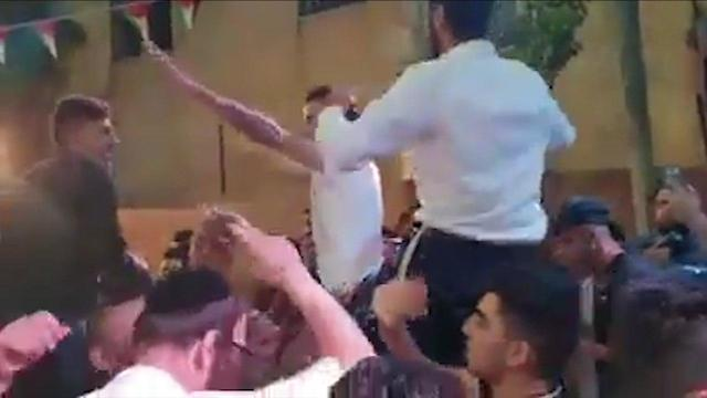 Israeli settlers participating in Palestinian wedding
