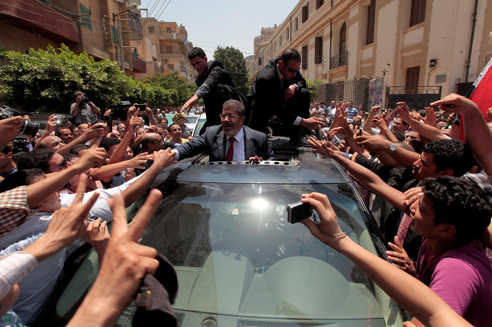 Mohamed Morsi being greeted by supporters in Cairo, June 2012 (Photo: Reuters)