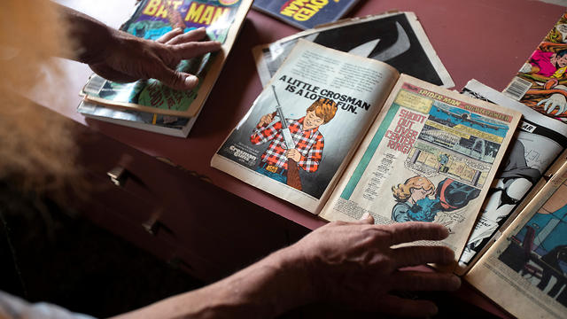 Michael Netzer shows a comic book he worked on at his attic in at his home on the settlement of Ofra on May 28, 2019