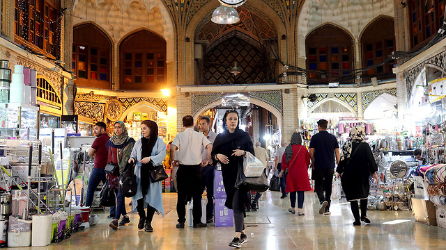 Iranians shopping at the Grand Bazaar in Tehran, June 2019 (Photo: AP) (Photo: AP)