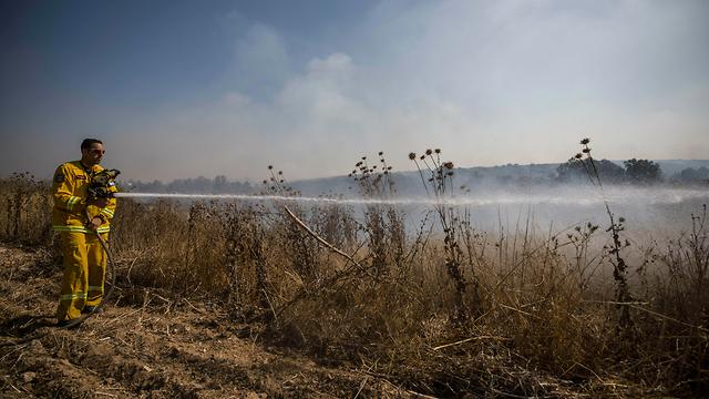 Firefighter battles a blaze in Gaza border region  (Photo: AP)