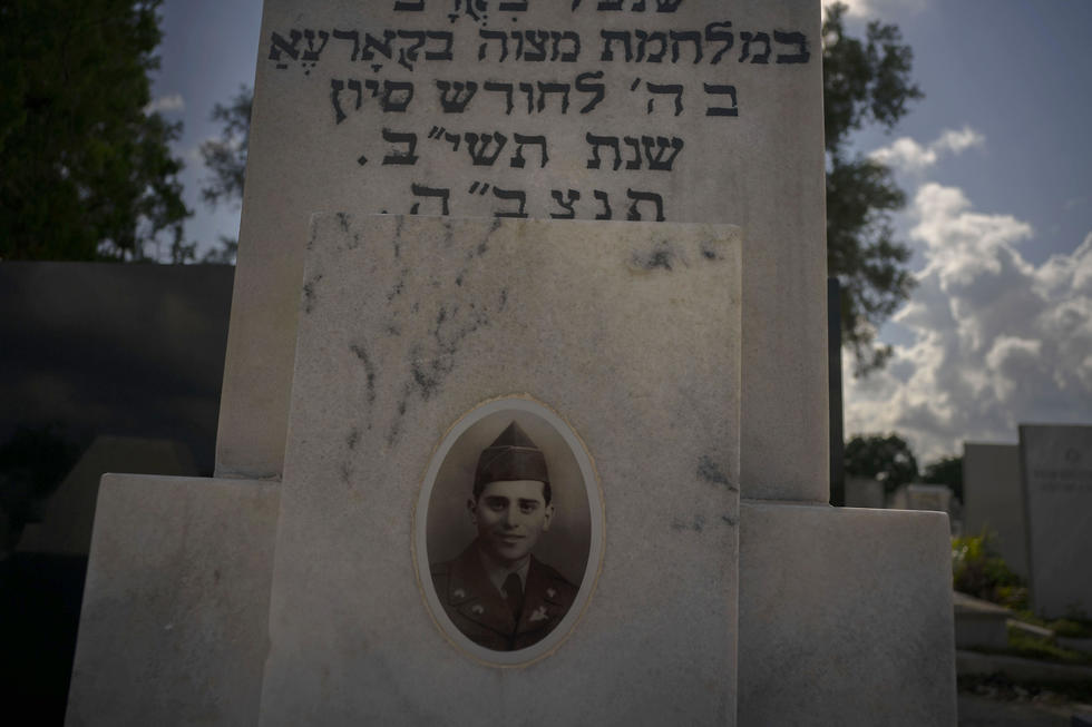 The portrait of a young Cuban soldier who died fighting in The Korean War decorates his tomb  (AP)
