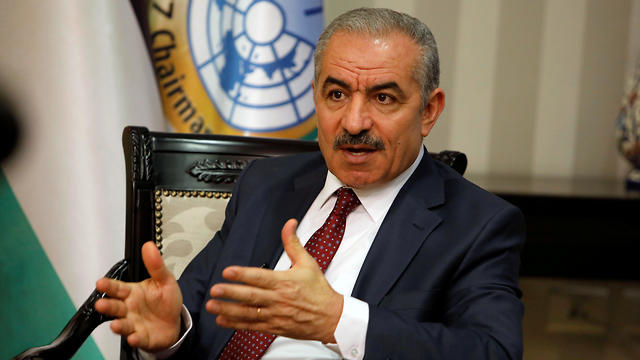 Palestinian Prime Minister Mohammed Shtayyeh at his office in Ramallah, June 27, 2019 (Photo: Reuters)