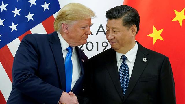 דונלד טראמפ שי ג'ינפינג ב ועידת G20  (צילום: רויטרס)