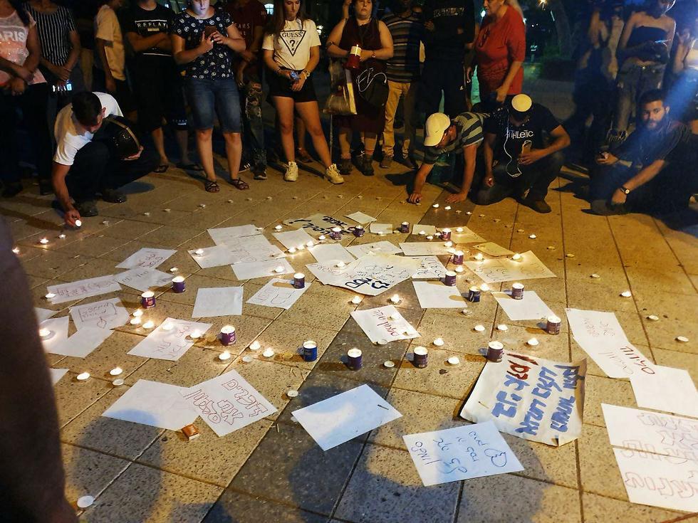Teens gather in the park where Solomon Tekah was killed (Photo: Gil Nehushtan )