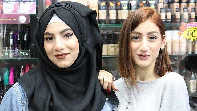 Riham Rajab and a friend in East Jerusalem (Photo: Andrew Sweeney)