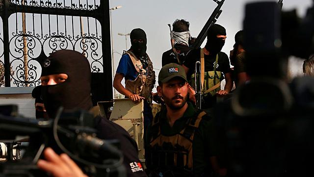 בצרה עיראק אל-חשד א-שעבי PMF מיליציות שיעיות הגיוס העממי (צילום: AP)
