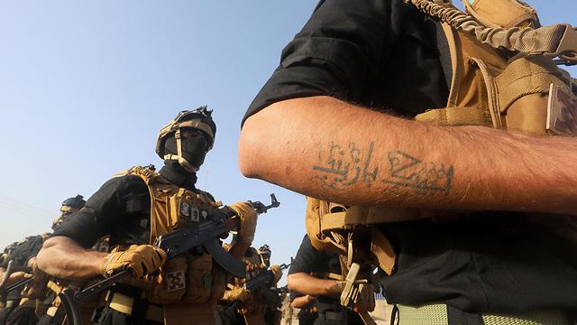 בצרה עיראק אל-חשד א-שעבי PMF מיליציות שיעיות הגיוס העממי (צילום: רויטרס)