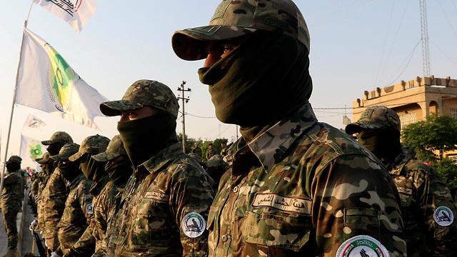 עיירה טזה ליד כירכוכ עיראק אל-חשד א-שעבי PMF מיליציות שיעיות הגיוס העממי (צילום: רויטרס)