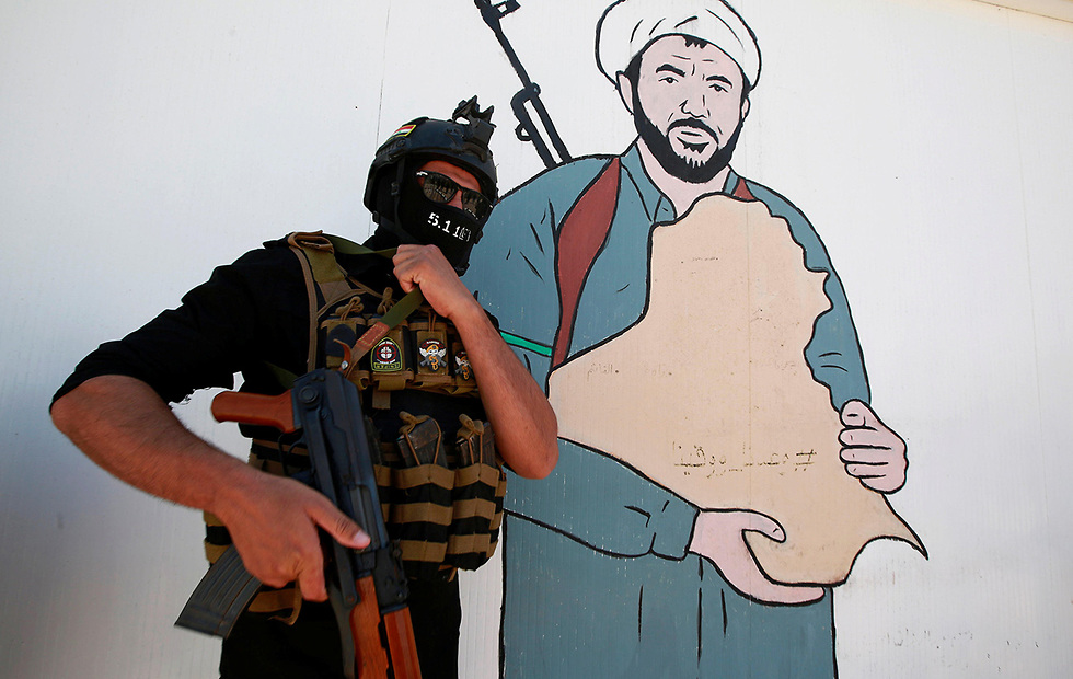 נג'ף עיראק עיראק אל-חשד א-שעבי PMF מיליציות שיעיות הגיוס העממי (צילום: רויטרס)