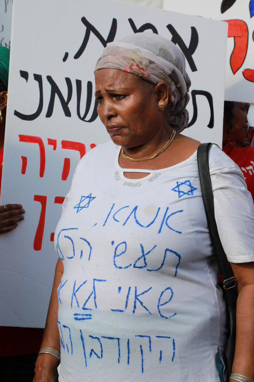 A protester in Tel Aviv. Her t-shirt reads: 'Mom, do everything you can to ensure I am not the next victim' (Photo: Dana Kopel)