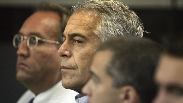 Jeffrey Epstein (center) is shown in a Palm Beach County courtroom on July 30, 2008, where he pleaded guilty to two prostitution charges