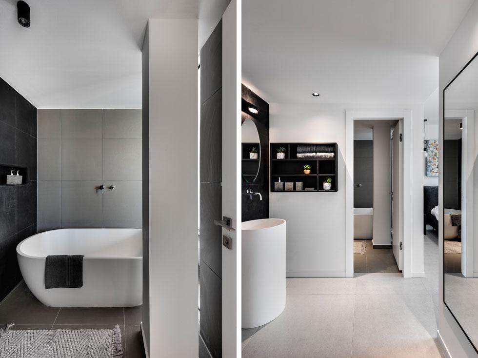 """הקירות כוסו באפור, וכיור רחצה לבן על רקע שחור תוכנן מחוץ לחדר הרחצה, בין חדר השינה והממ""""ד (צילום: עודד סמדר)"""