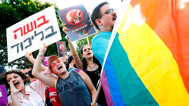 Protesters near the residence of Education Minister Rafi Peretz following his comments in favor of conversion therapy (Photo: AFP)