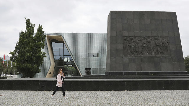 A woman passes the Museum of the History of Polish Jews 'POLIN' in Warsaw