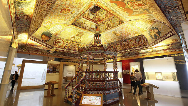 Visitors are appreciating a reconstruction of a wooden 17th century synagogue at the Museum of the History of Polish Jews POLIN in Warsaw
