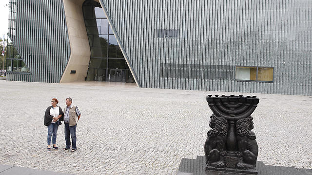 People stand in front of the Museum of the History of Polish Jews 'POLIN' in Warsaw, Poland, Tuesday, 16 July 2019