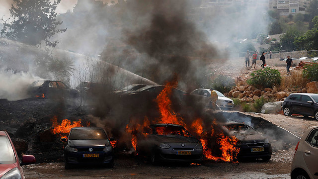 Cars burning in the Jerusalem Technology Park  (Photo: AFP)