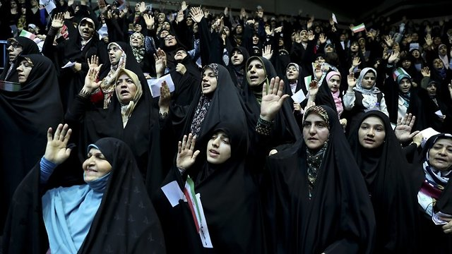 Veiled Iranian women attend a ceremony in support of the observance of the Islamic dress code for women