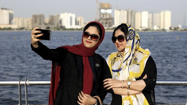 Iranians take selfie around of the Persian Gulf Martyrs lake, west of Tehran