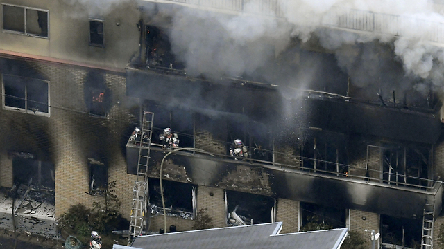 Firefighters battle a blaze at Kyoto Animation (Photo: Reuters)