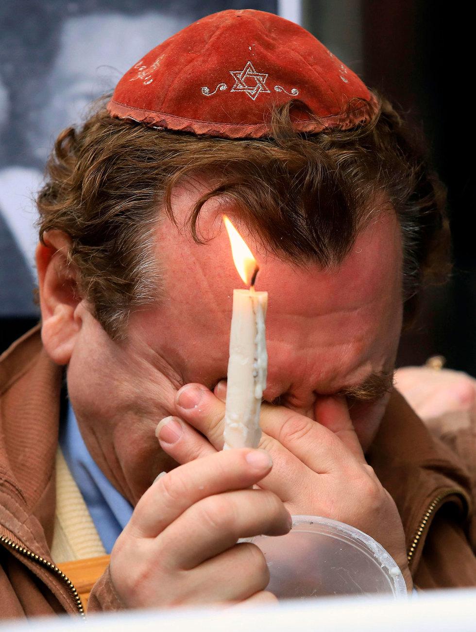 בואנוס איירס ארגנטינה עצרת 25 שנה ל פיגוע בניין הקהילה היהודית (צילום: AFP)