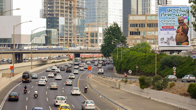 The controversial billboard overlooks the Ayalon Highway (Photo: Halel Meir)
