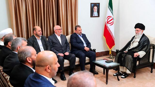 Iranian Supreme Leader Ayatollah Ali Khamenei meeting with a Hamas delegation in Tehran (Photos: AP, Office of the Iranian Supreme Leader)