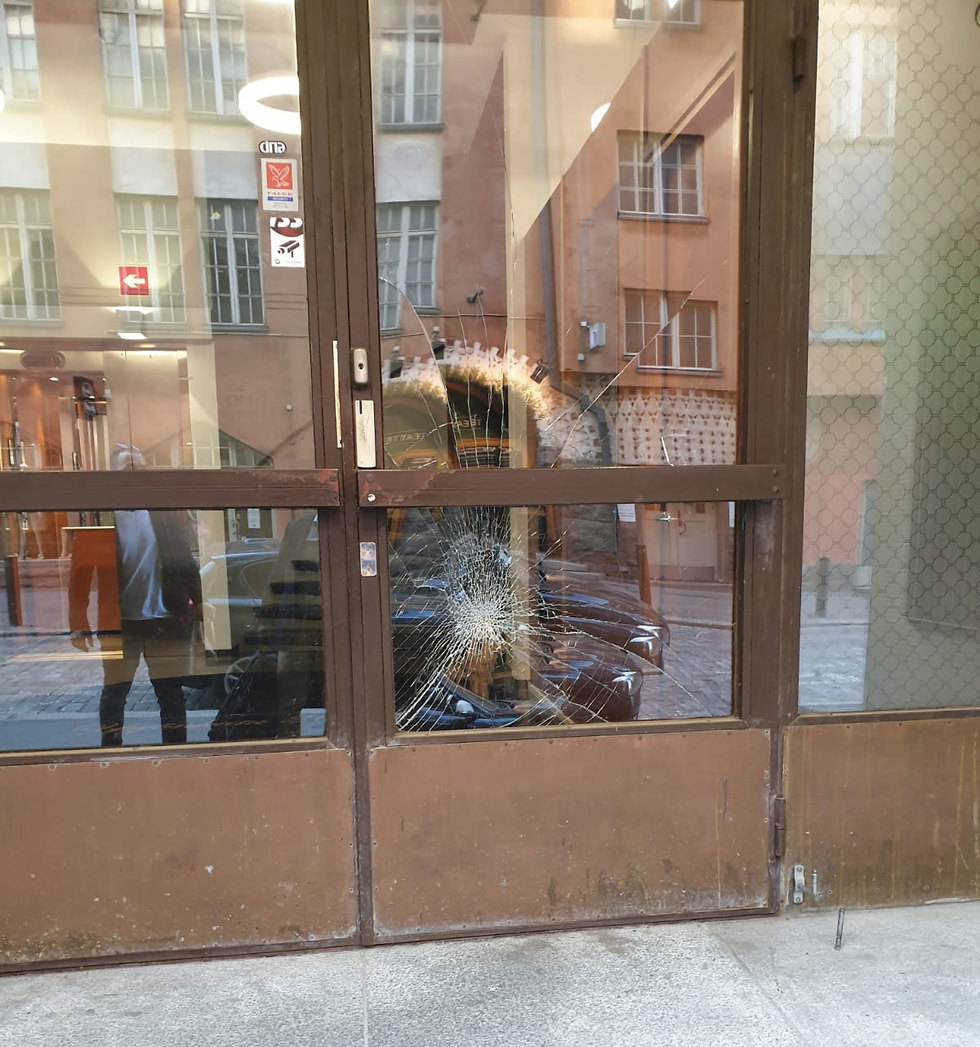 Glass doors of the embassy shattered by vandals