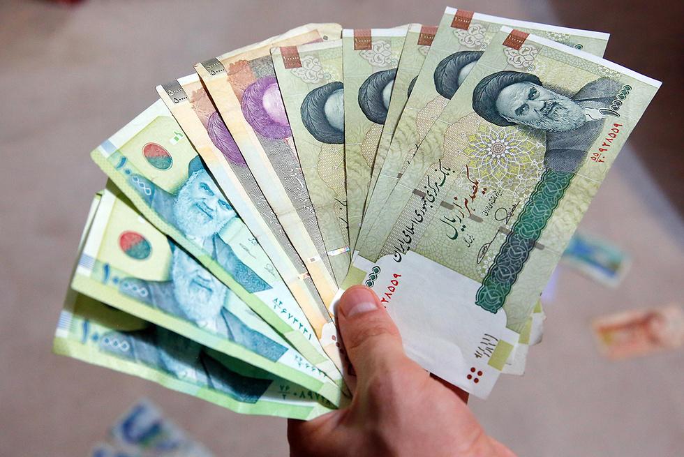 איראן מטבע ריאל איראני  (צילום: EPA)