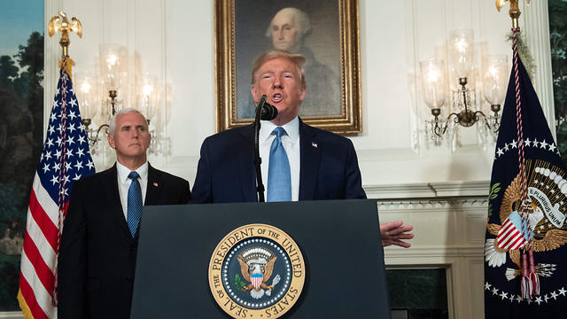 US President Donald Trump speaks alongside Vice President Mike Pence from the Diplomatic Reception Room of the White House in Washington, DC, August 5, 2019