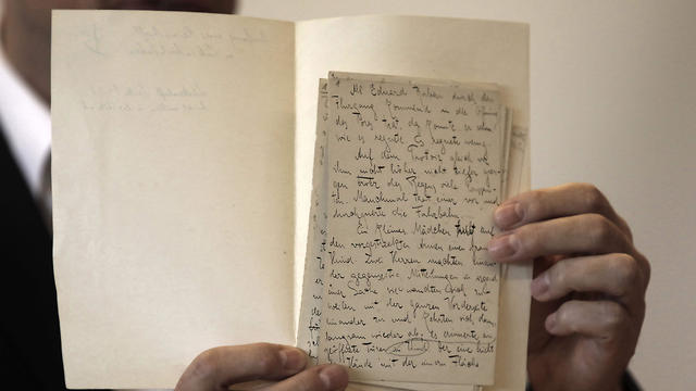 National Library archival expert and Humanities Collection Curator Stefan Litt reveals a a manuscripts by novelist Franz Kafka, during a press conference at the National Library of Israel in Jerusalem on August 7, 2019
