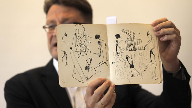 National Library archival expert and Humanities Collection Curator Stefan Litt reveals a a manuscripts by novelist Franz Kafka, during a press conference at the National Library of Israel